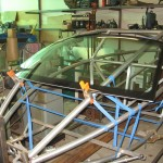 VW New Beetle windshield gets cut down to fit between frame rails